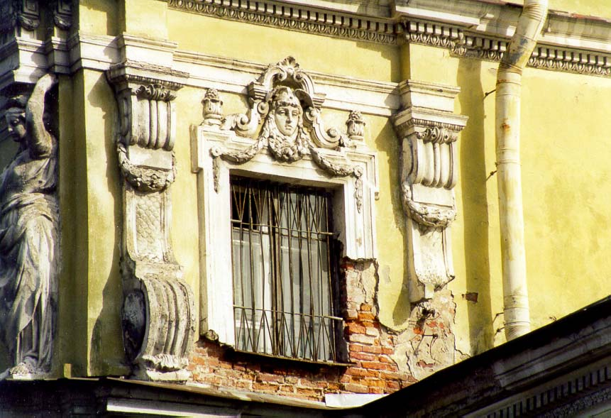 Decaying plaster on a building of 4th Central...Summer Garden. St.Petersburg, Russia