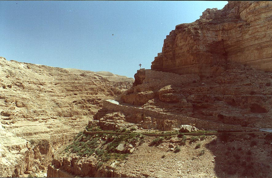 A road to St.George Monastery and an aqueduct in...River, near Jericho. The Middle East