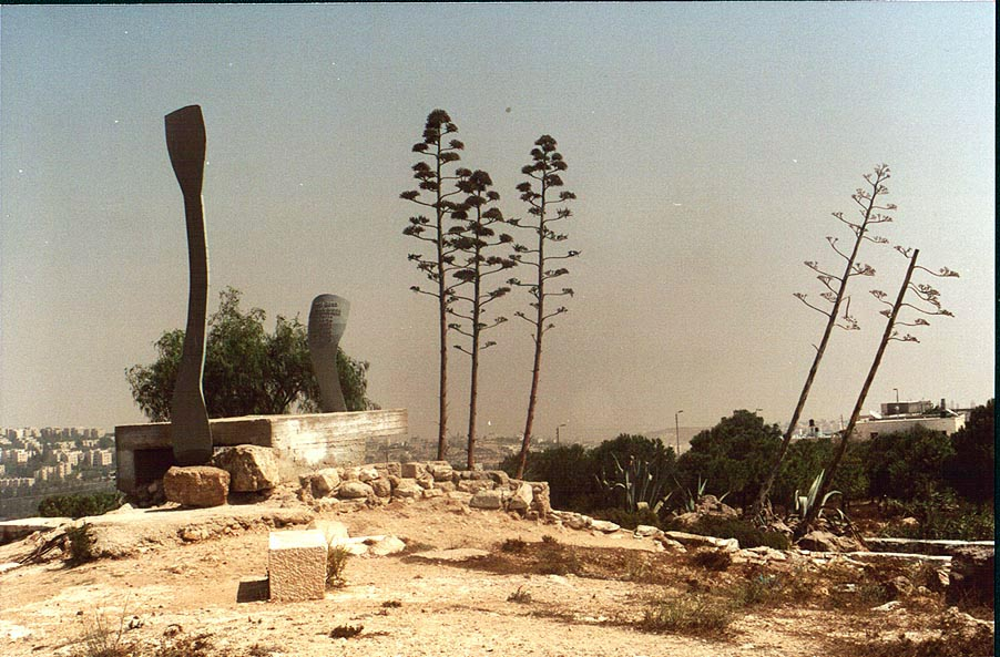 An abstract monument with agaves in bloom at Ramat Rahel. Jerusalem, the Middle East
