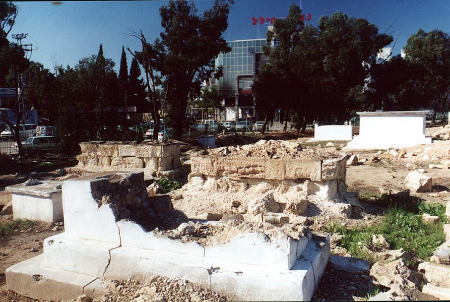 Blown gravestones on an abandoned Moslem Cemetery in downtown Beer-Sheva. The Middle East