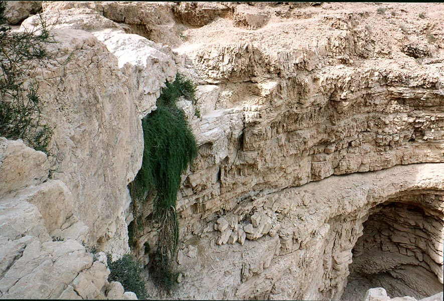 Giant dry waterfall at the end of a canyon of...of a desert plateau. The Middle East