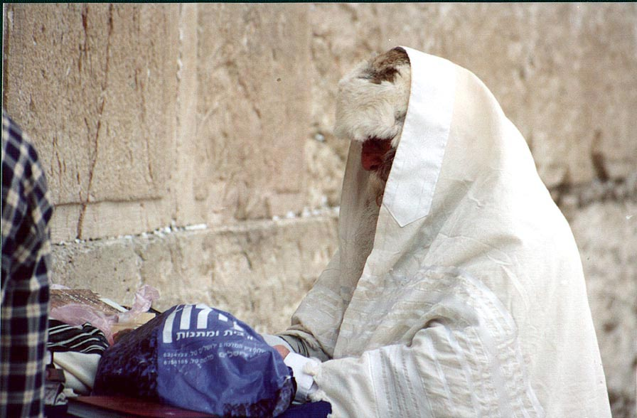Old City, a worshiper at Western Wall. Jerusalem, the Middle East