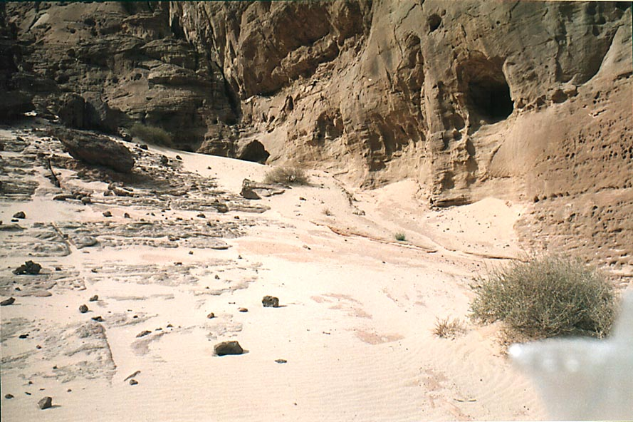 White sand and caves at the foot of Timna cliffs...Park, near Eilat. The Middle East