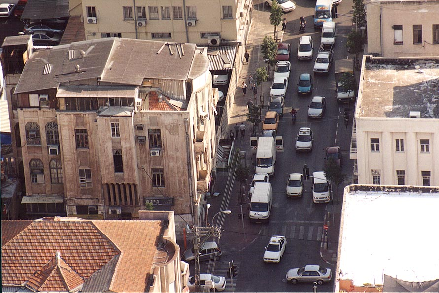Jamming traffic at Herzl St. at intersection with...tower. Tel Aviv, the Middle East