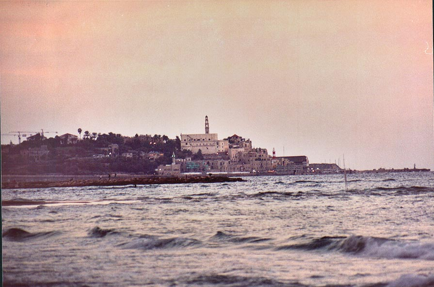 View of Old Jaffa from Tel Aviv beach after sunset. The Middle East
