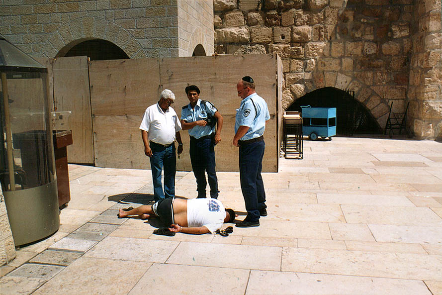 Western Wall. A person was handcuffed and...them. Jerusalem, the Middle East
