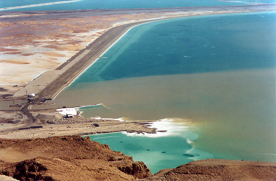 A dam and a shallow area of Dead Sea from cliffs above Ein Bokek. The Middle East