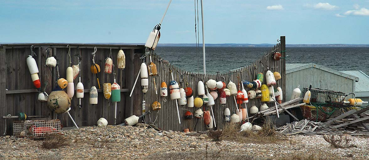 Floats on a fence of a house in Little Beach of...Pond in south Dartmouth. Massachusetts