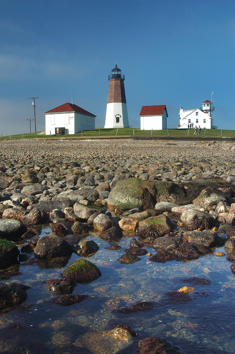 Point Judith Lighthouse in Narragansett at low tide. Rhode Island