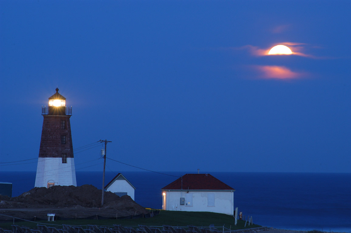 Moonrise over Point Judith Lighthouse in...view from a WWII bunker. Rhode Island