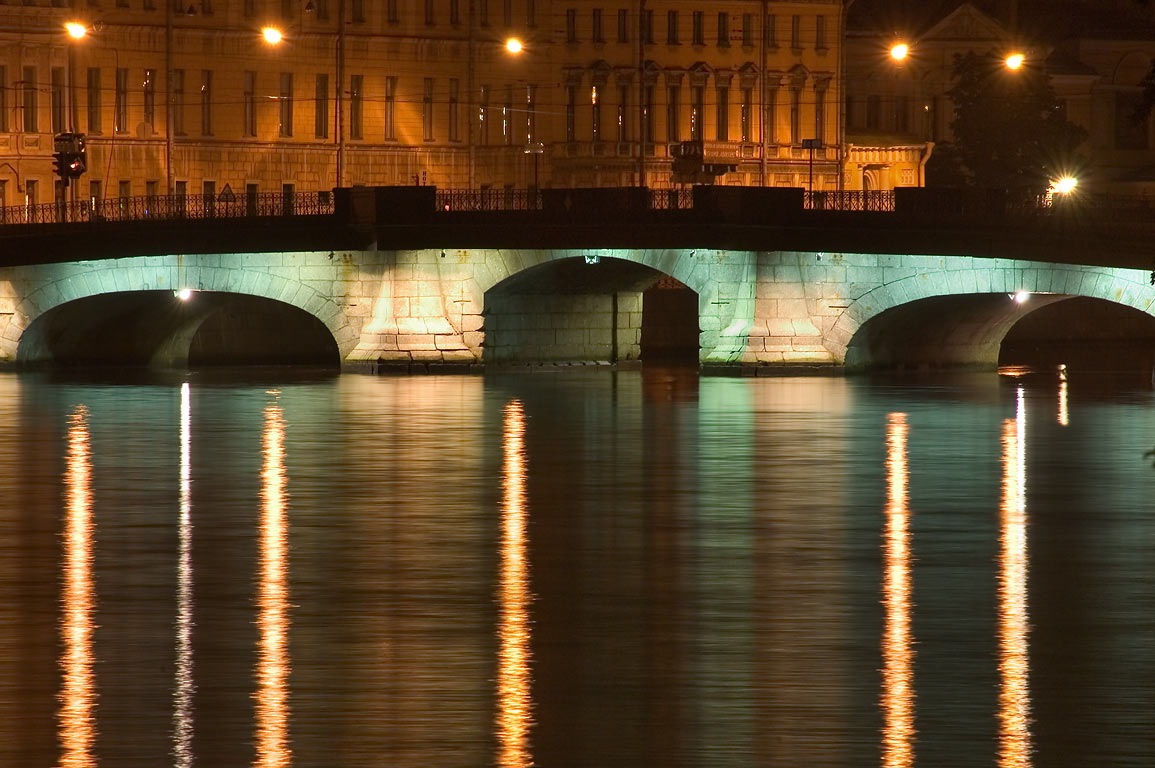 A bridge across Fontanka River at night. St.Petersburg, Russia