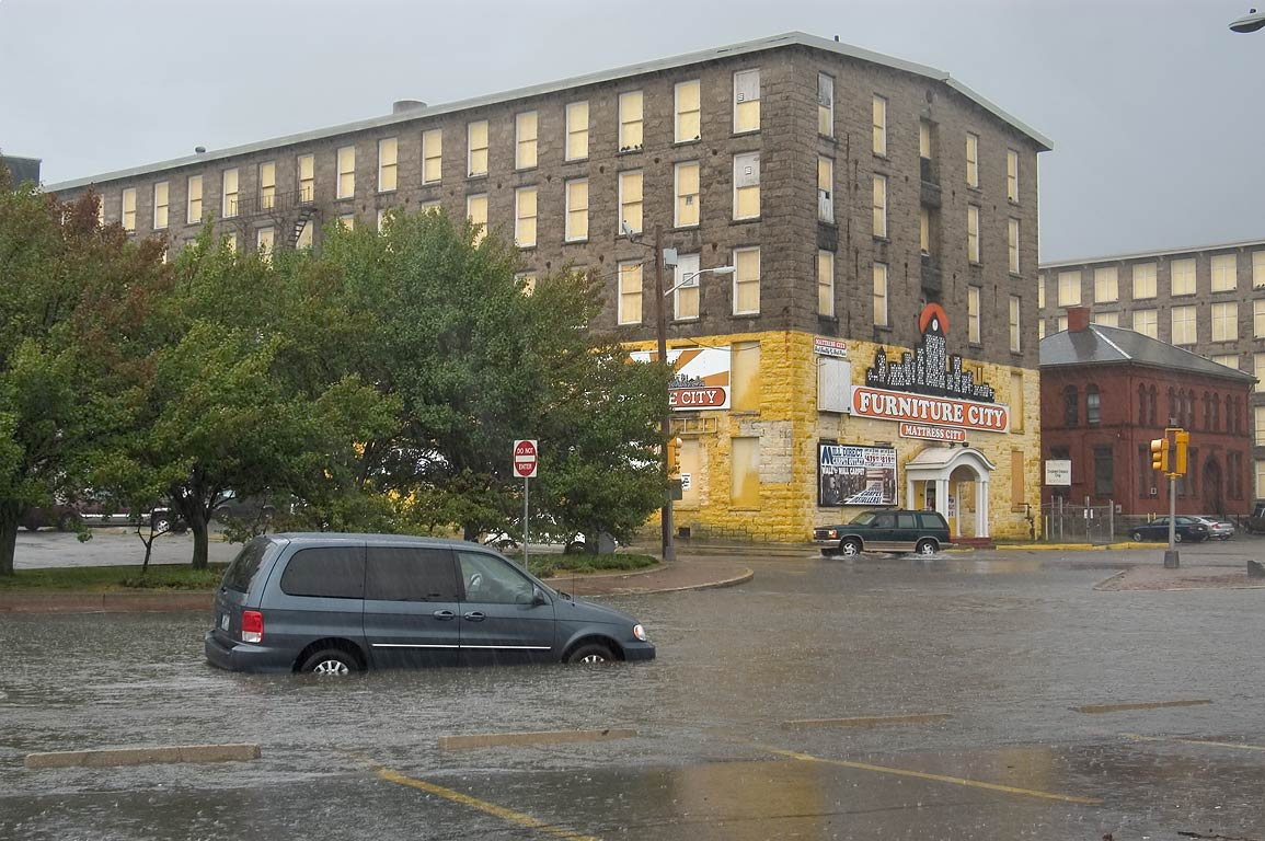 A mill and flooded Pleasant St.. Fall River, Massachusetts