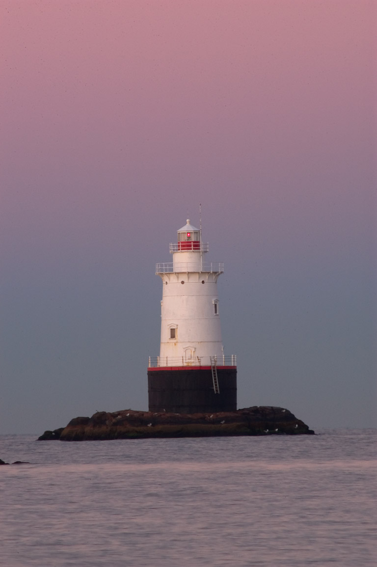 Sakonnet Point Lighthouse (zoomed), view from a...morning. Little Compton, Rhode Island