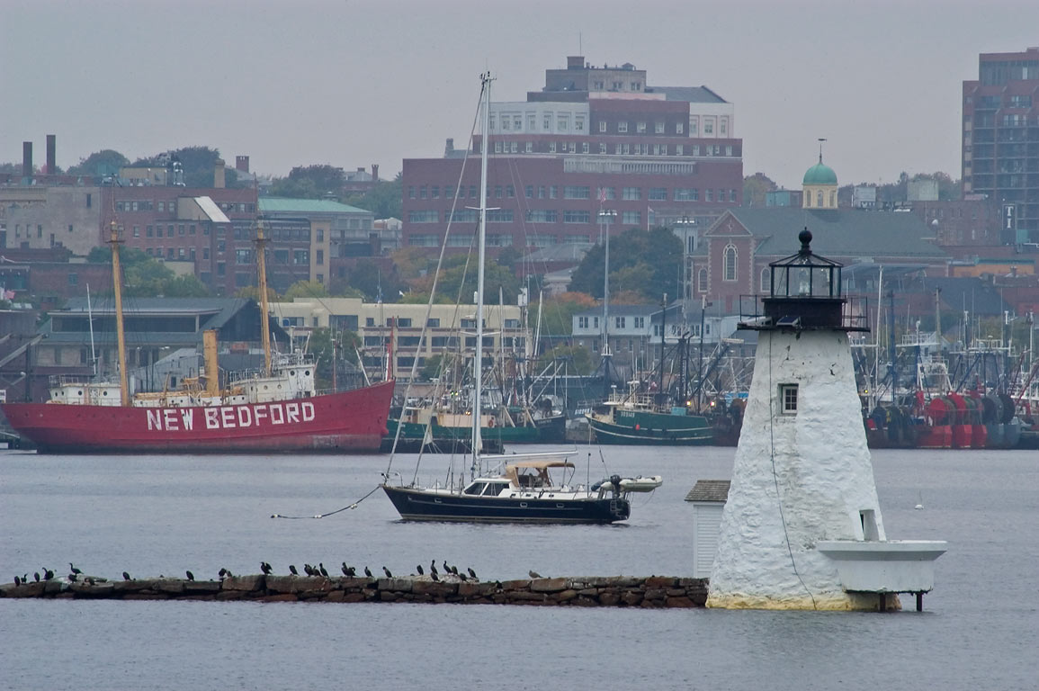 Palmer Island Light and fishing fleet in New...Phoenix in Fairhaven. Massachusetts