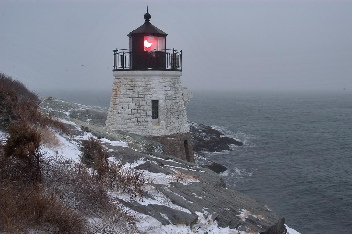 Castle Hill Lighthouse at the beginning of snowfall. Newport, Rhode Island
