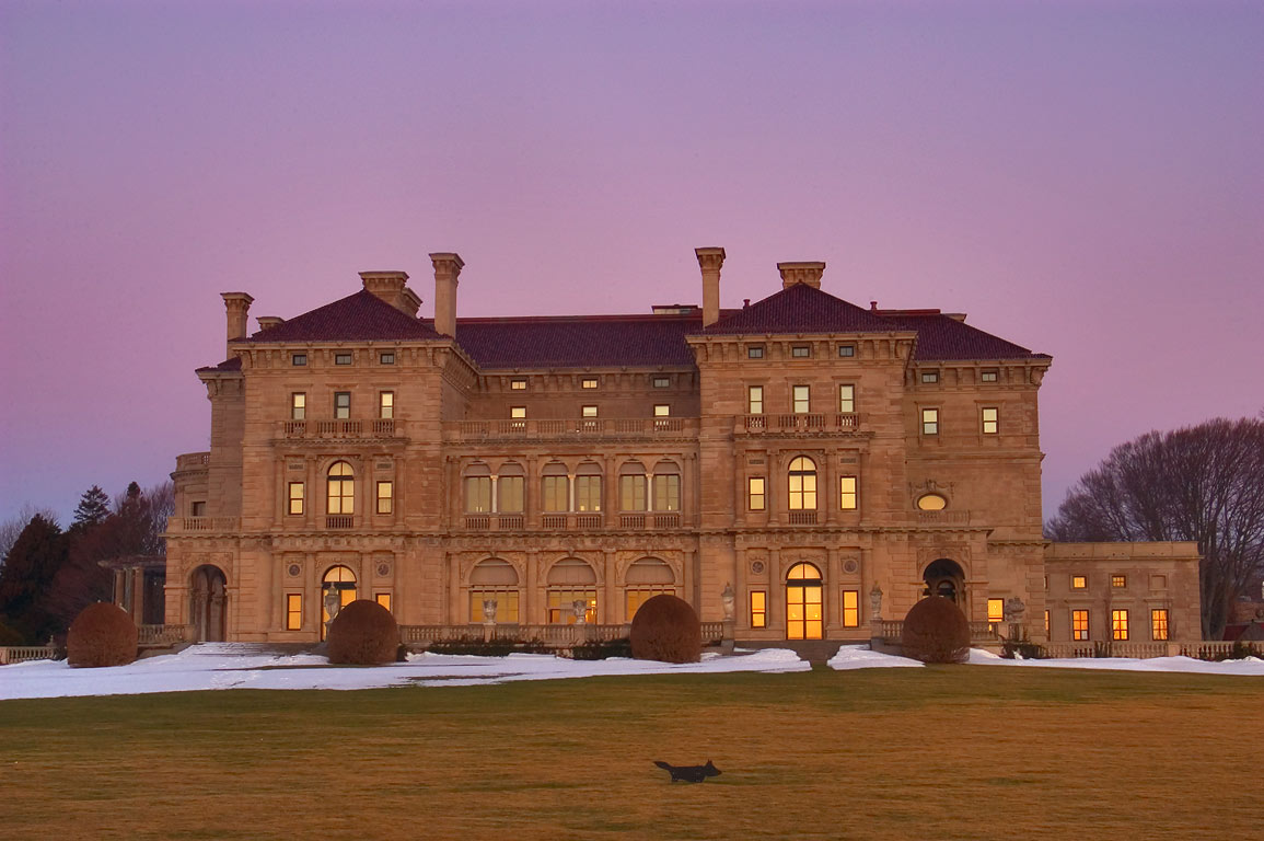 Breakers Mansion before sunrise, view from Cliff Walk trail. Newport, Rhode Island