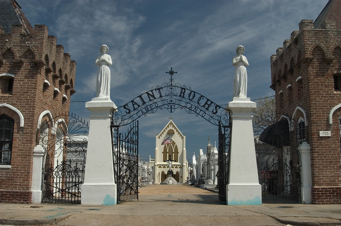 Entrance lodges and gates of St.Roch Cemetery No...the background. New Orleans, Louisiana
