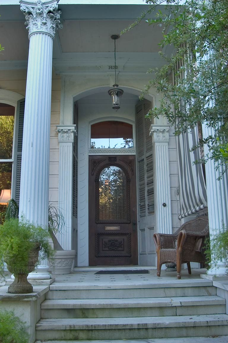 Marble porch with wicker of Jacob L. Cureton Jr...District. New Orleans, Louisiana
