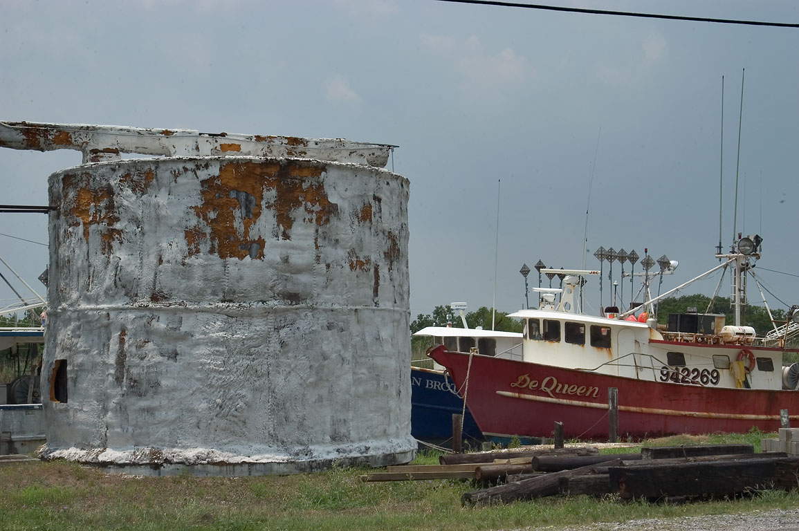 "Abandoned cistern and ""De Queen"" boat near Rd. 57, Terrebonne Parish. Louisiana"