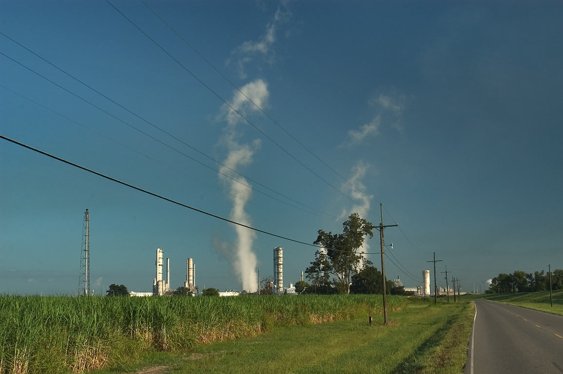 Cane fields, plants and refineries along Old...Route 18), near St.James. Louisiana