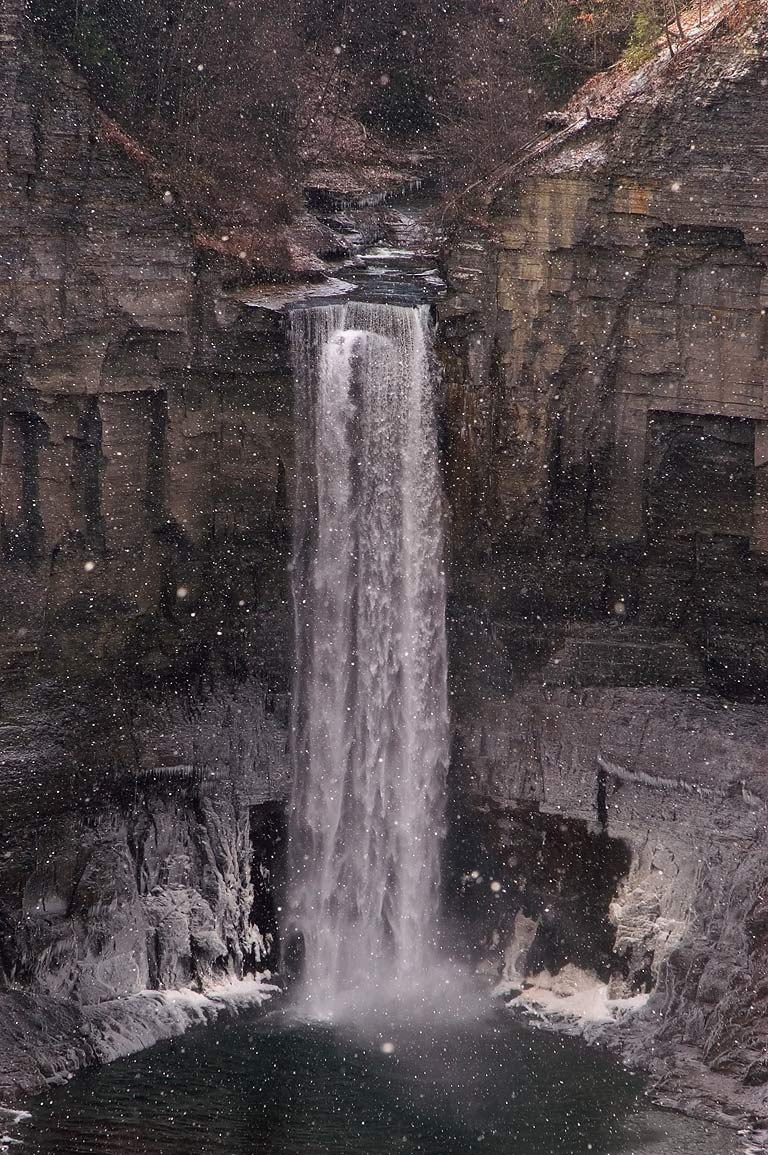 Taughannock Falls near Ithaca, view from upper falls overlook, at light snowfall. New York