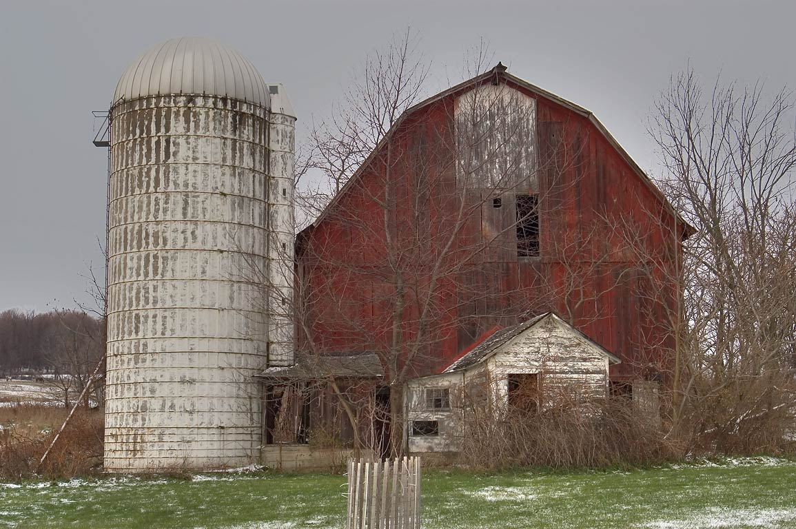 A barn and a silo near Halseyville Rd. west from Ithaca. Enfield, New York