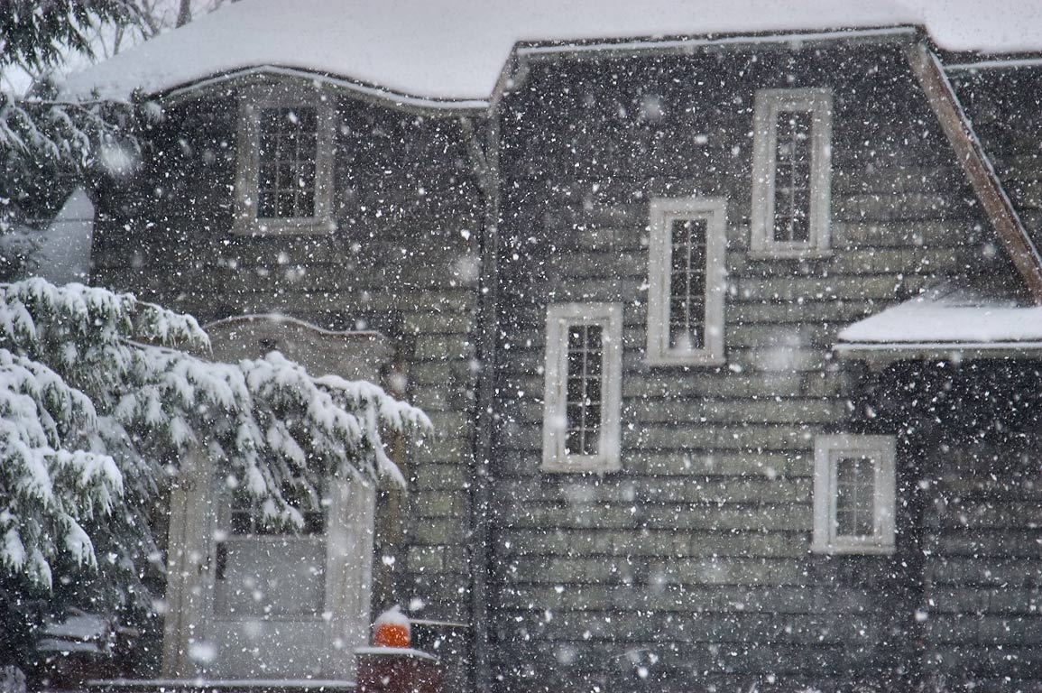 A house at Cayuga Heights Rd. during heavy snowfall. Ithaca, New York