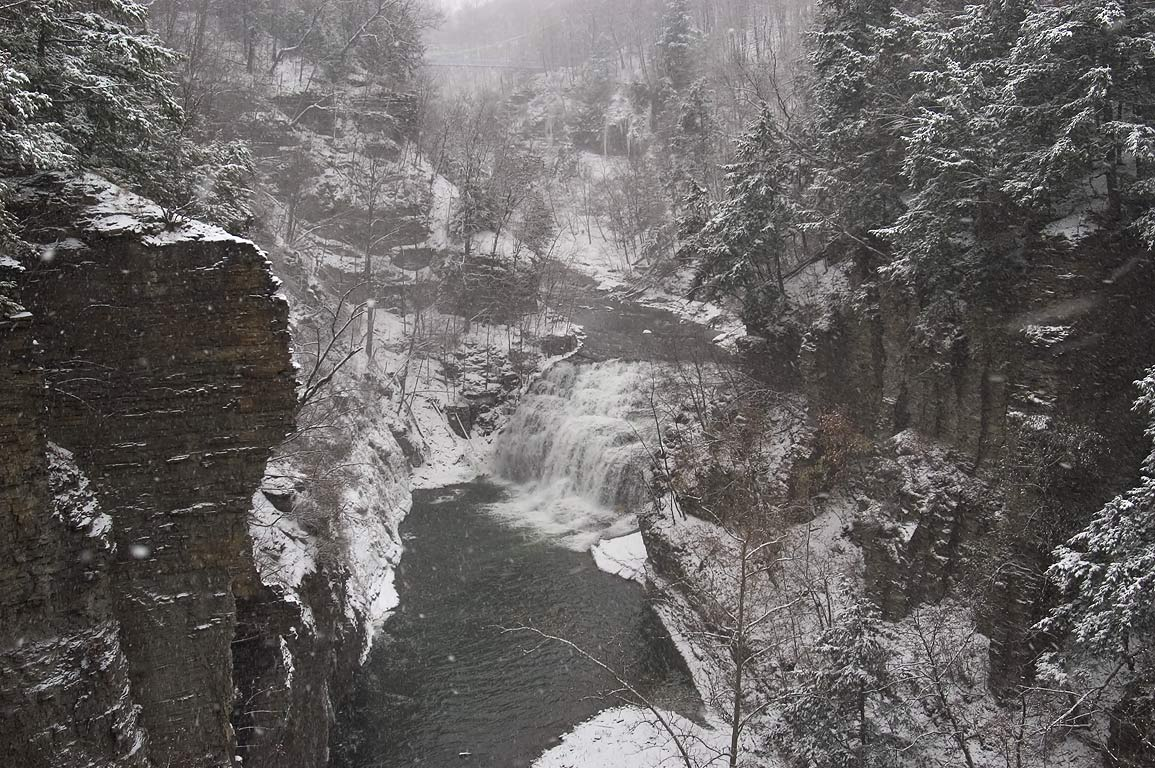 Fall Creek to the east from Lake St. bridge, in snow. Ithaca, New York