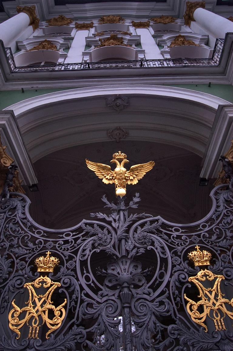 Gates of a yard of Hermitage Museum, with a Russian emblem. St.Petersburg, Russia