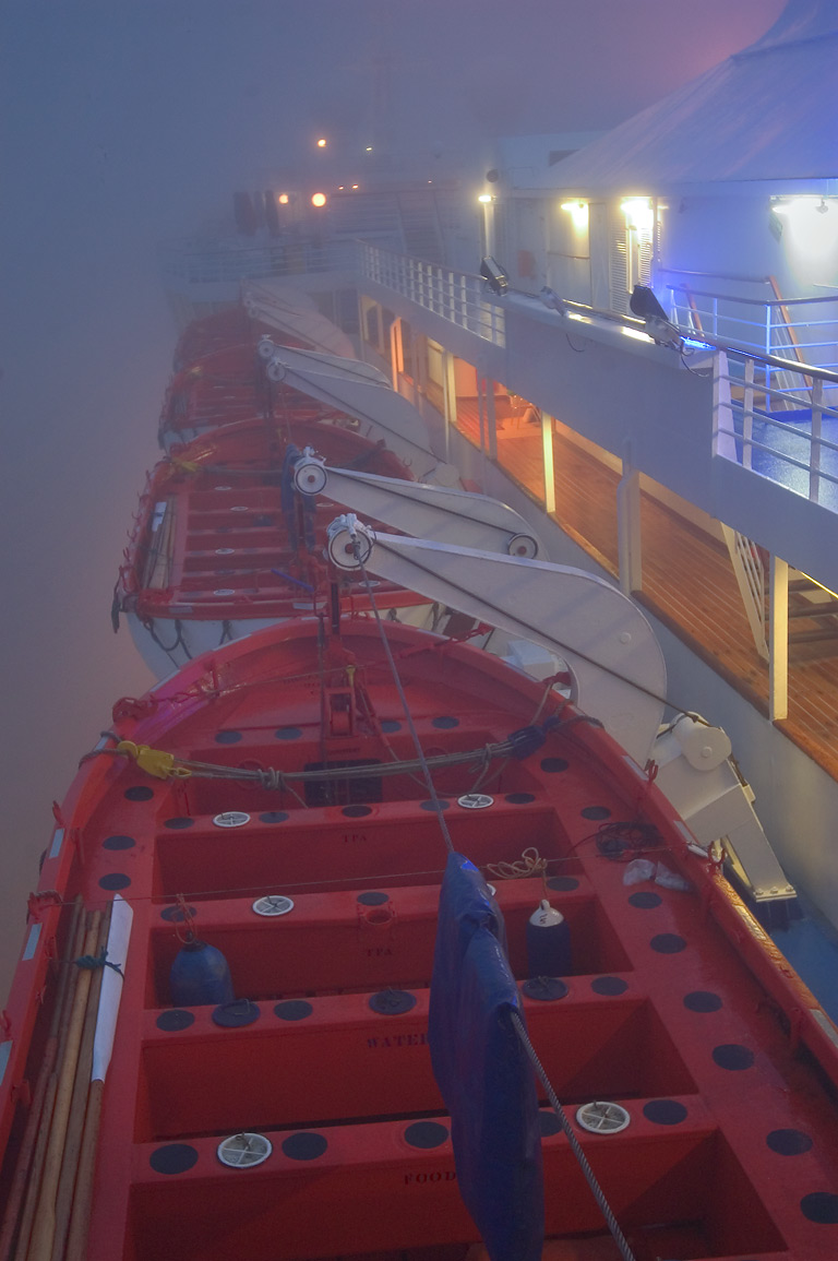 Lifeboats from the upper deck of cruise ship...fog at morning. New Orleans, Louisiana