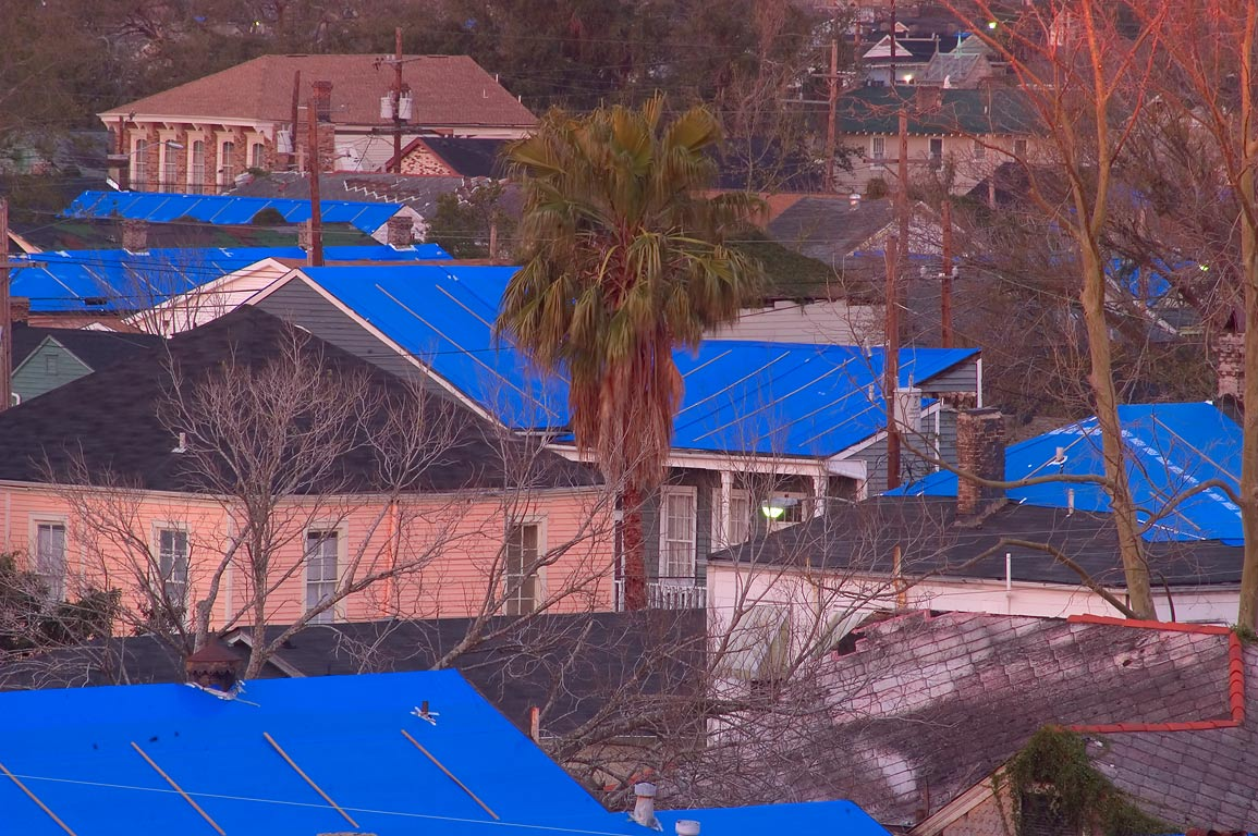 Blue tarp protecting roofs at First St. near St...an apartment. New Orleans, Louisiana