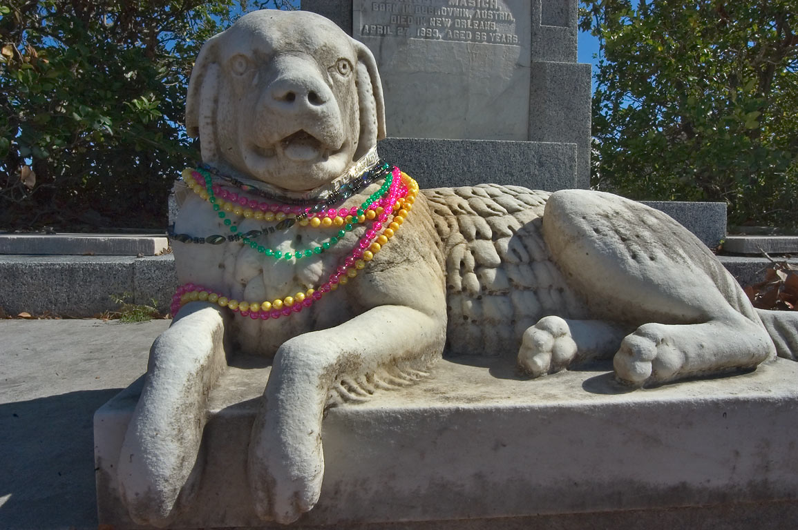 A weeping dog sculpture on a tomb of Francis...Cemetery. New Orleans, Louisiana