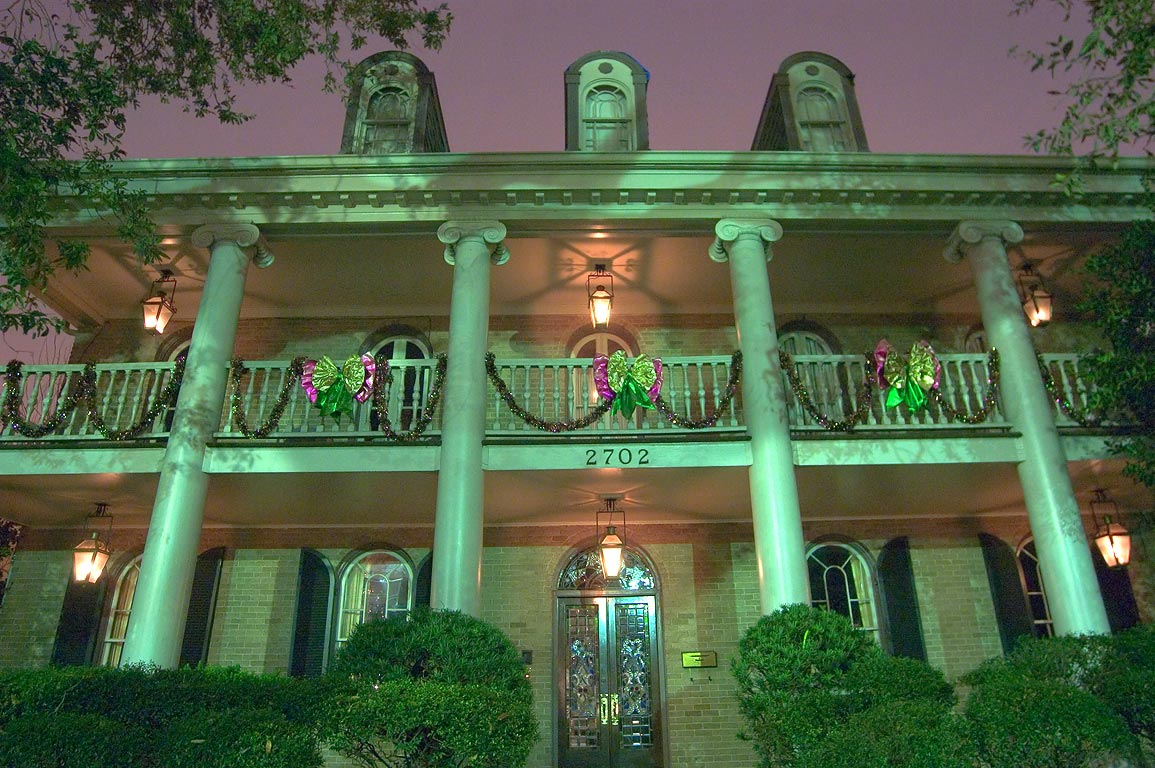 A house at 2702 St.Charles Ave, with Mardi Gras decorations. New Orleans, Louisiana