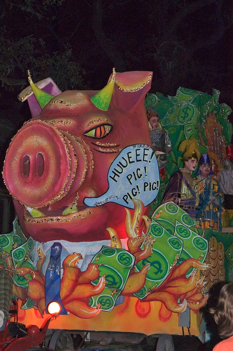 Pig float of krewe of Chaos at Mardi Gras parade...Charles Ave.. New Orleans, Louisiana