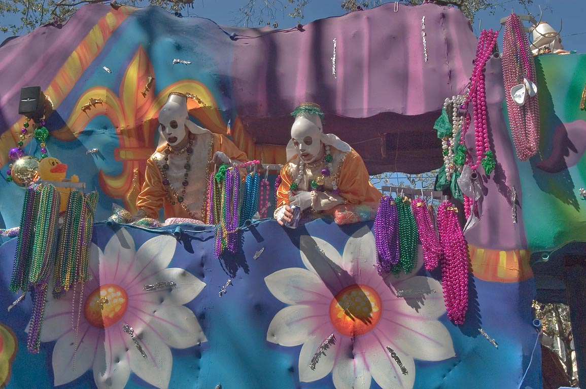 Bead throwers at Mardi Gras parade of krewe of...Charles Ave.. New Orleans, Louisiana