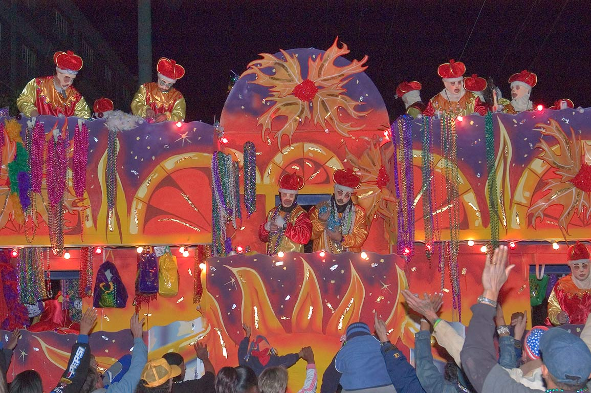 Red and orange float of krewe of Endymion at...Charles Ave.. New Orleans, Louisiana