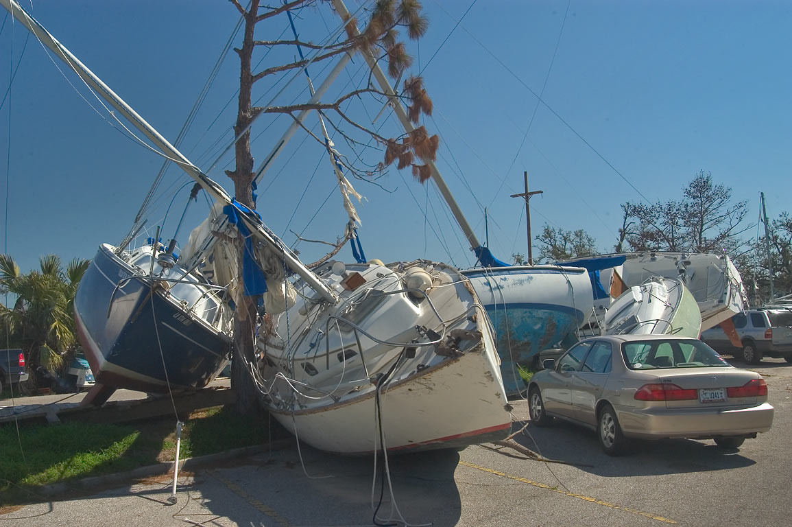 Yachts grounded on parking space of North Roadway...Pontchartrain. New Orleans, Louisiana