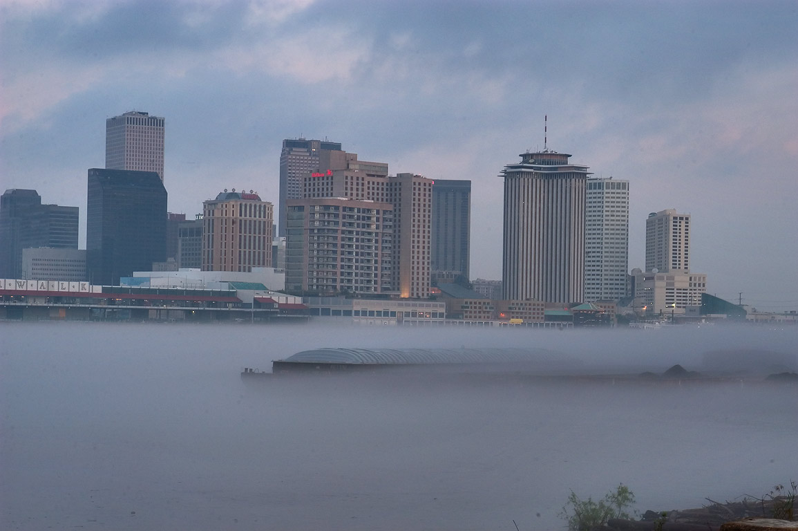 A barge in Mississippi River and Business...at morning. New Orleans, Louisiana