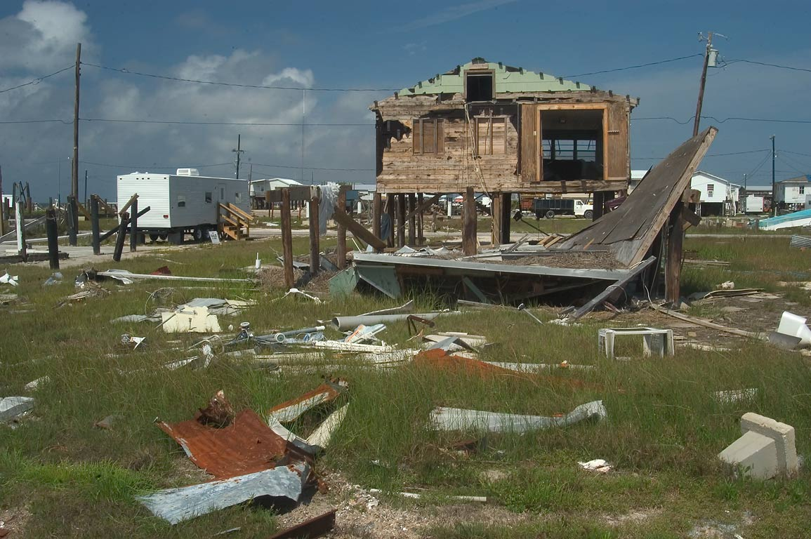 A damaged house and FEMA trailer near Speckled Trout Lane in Grand Isle. Louisiana
