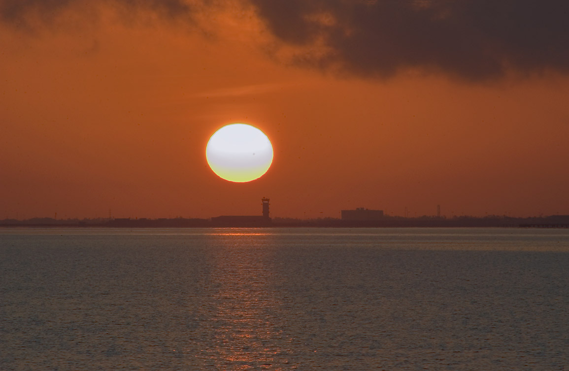 Sunrise over Lake Pontchartrain from Breakwater...at horizon. New Orleans, Louisiana