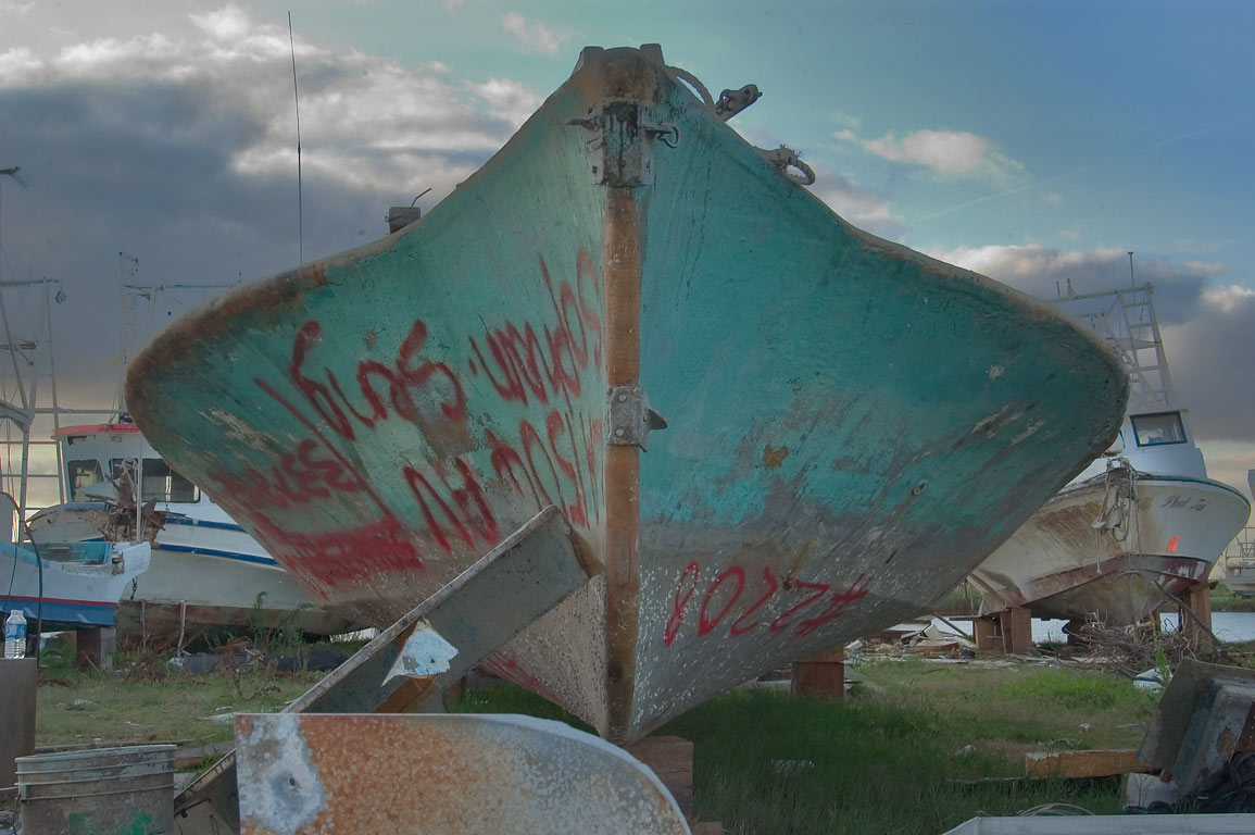 A fishing boat No. 2208 in Empire shipyard staging area. Plaquemines Parish, Louisiana