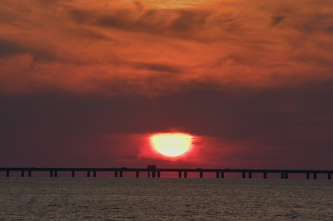 Sunset over Pontchartrain Causeway from...in West End. New Orleans, Louisiana