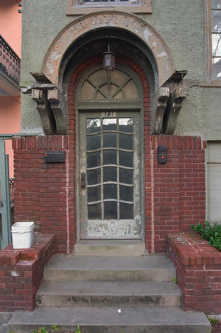 A doorway at 73 Prytania St., corner of Polymnia...District. New Orleans, Louisiana