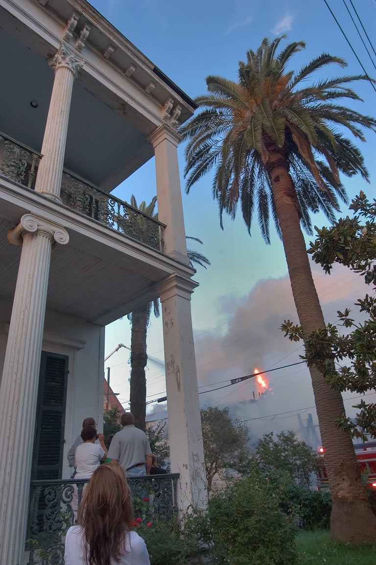 People watching a fire from 1303 St.Mary St. in...District. New Orleans, Louisiana