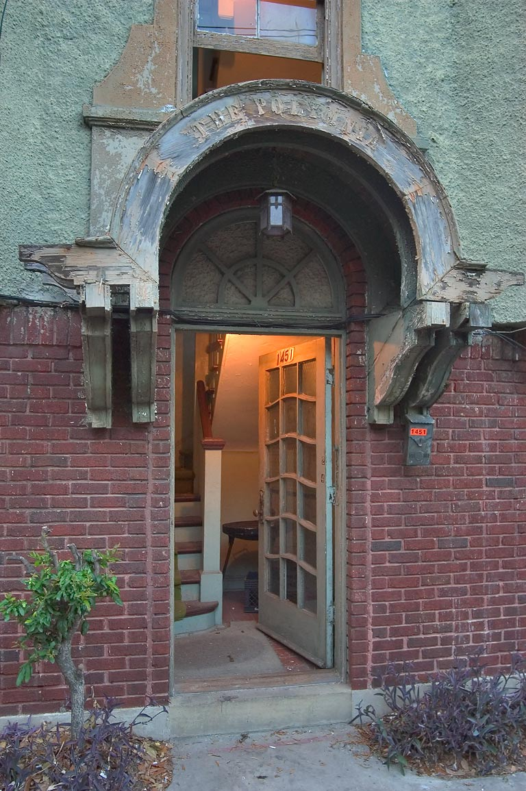 A doorway of apartments at 1451 Polymnia St., a...at evening. New Orleans, Louisiana