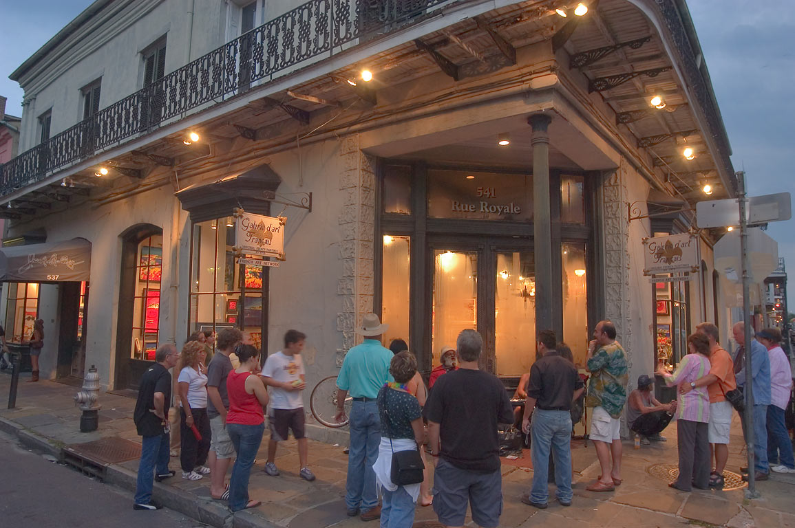 Tourists watching a street musician near Galerie...French Quarter. New Orleans, Louisiana