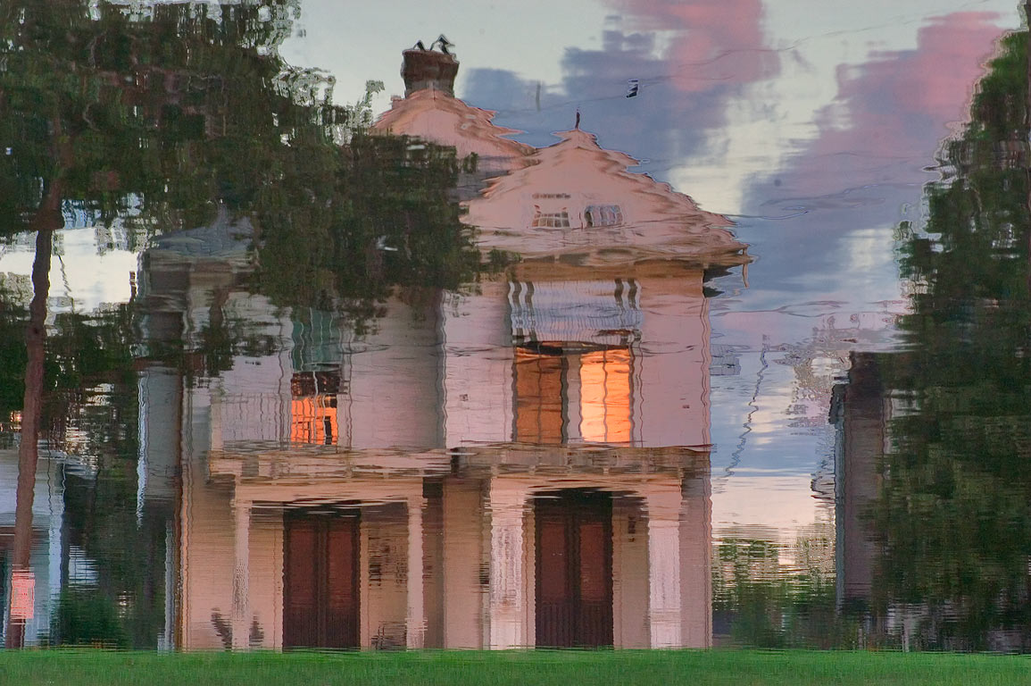 A wooden house on East Moss St. reflected in...flipped image). New Orleans, Louisiana
