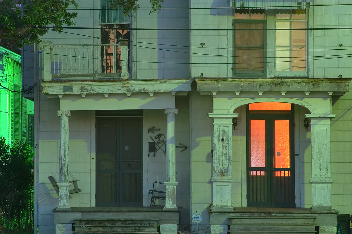A porch of a wooden house on East Moss St. in...at evening. New Orleans, Louisiana