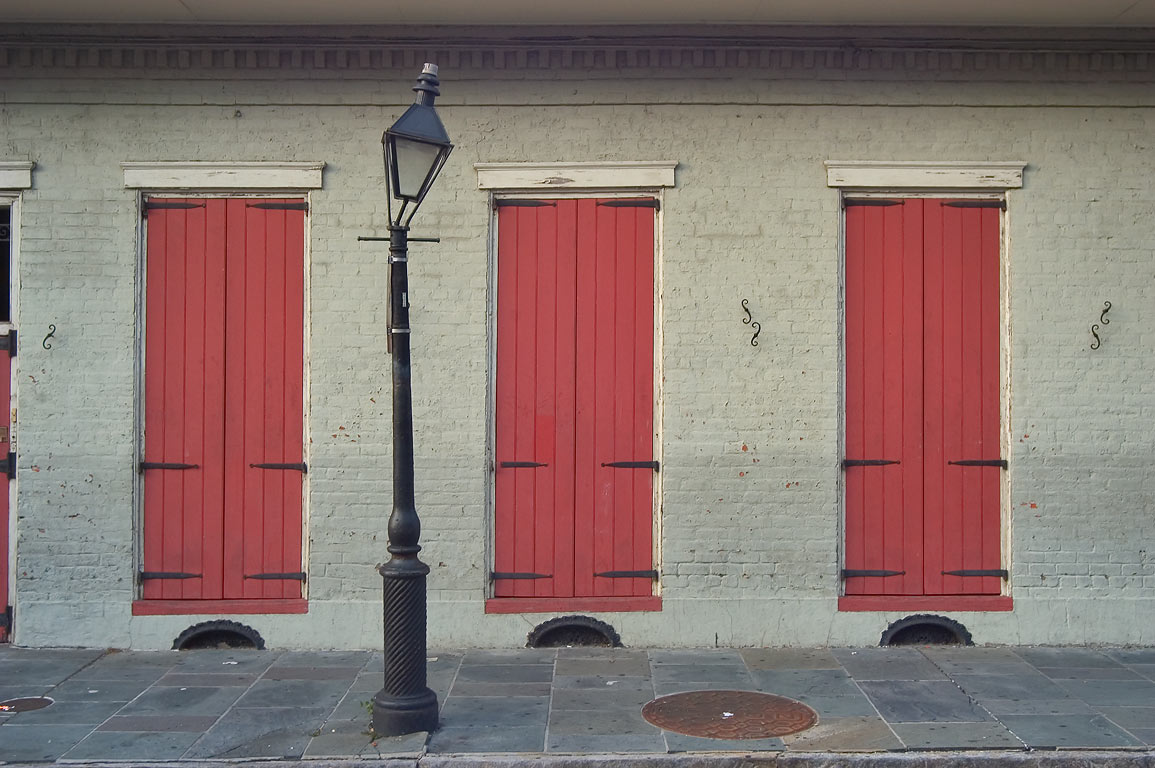 Doors of a creole cottage and a lamppost on St...French Quarter. New Orleans, Louisiana