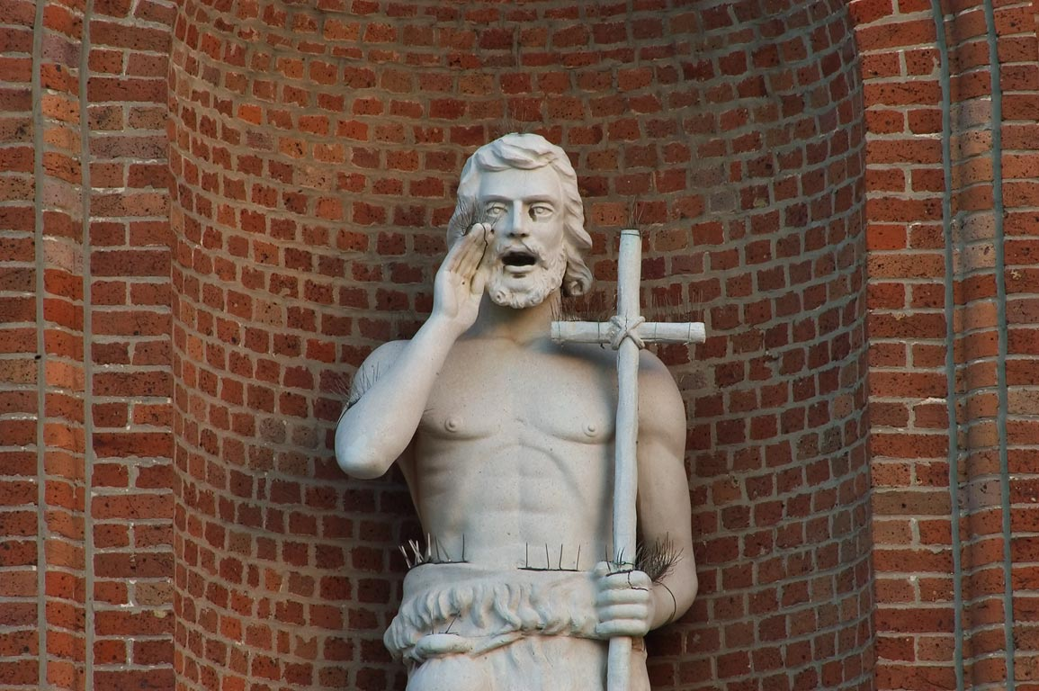 A statue of a shouting saint in a niche of St...Central City. New Orleans, Louisiana